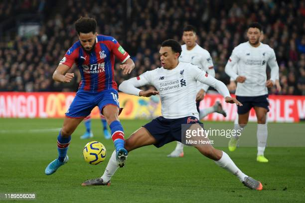 Trent AlexanderArnold of Liverpool tackles Andros Townsend of Crystal Palace during the Premier League match between Crystal Palace and Liverpool FC...