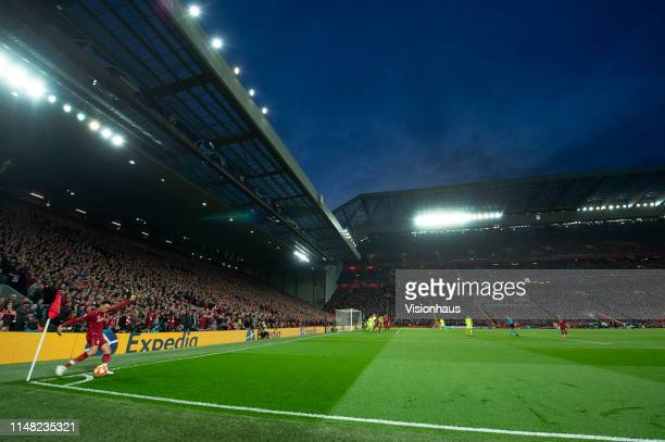 Trent AlexanderArnold of Liverpool takes a corner at the Kop end during the UEFA Champions League Semi Final second leg match between Liverpool and...