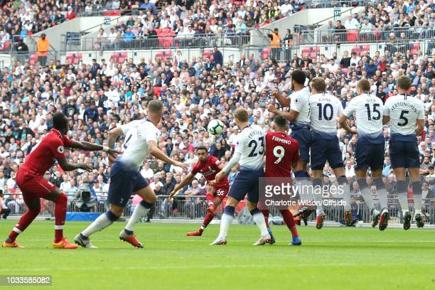 Trent AlexanderArnold of Liverpool takes a freekick during the Premier League match between Tottenham Hotspur and Liverpool FC at Wembley Stadium on...