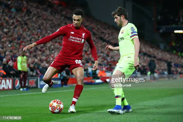 Trent AlexanderArnold of Liverpool takes on Sergi Roberto of Barcelona during the UEFA Champions League Semi Final second leg match between Liverpool...
