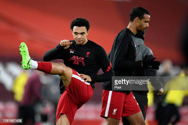Trent Alexander-Arnold of Liverpool warms up ahead of the Premier League match between Liverpool and Burnley at Anfield on January 21, 2021 in...