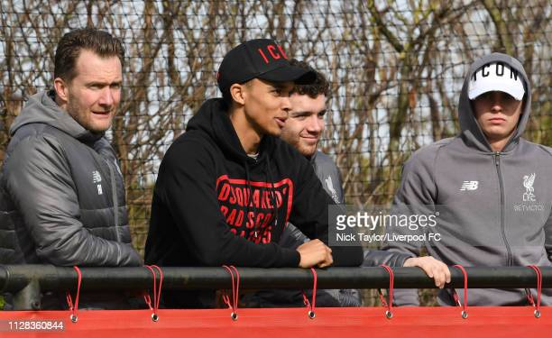 Trent AlexanderArnold of Liverpool watches the action with Academy Director Alex Inglethorpe and Ben Woodburn during the U18 Premier League game at...