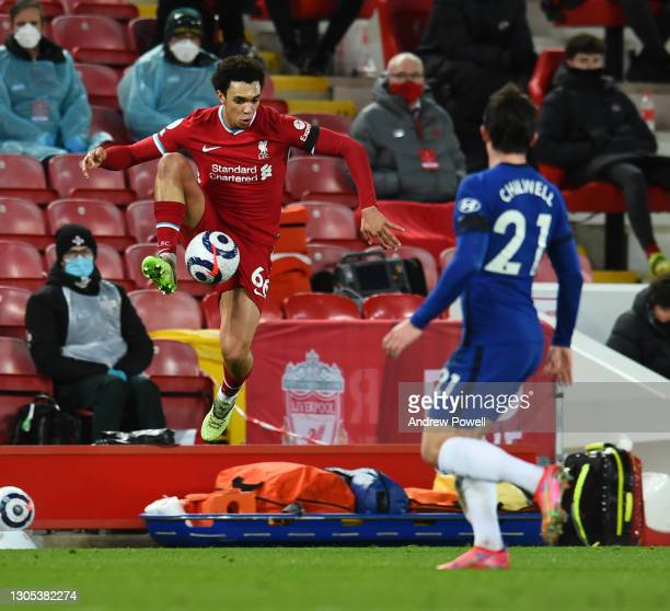 Trent Alexander-Arnold of Liverpool with Chelsea's Ben Chilwell during the Premier League match between Liverpool and Chelsea at Anfield on March 04,...