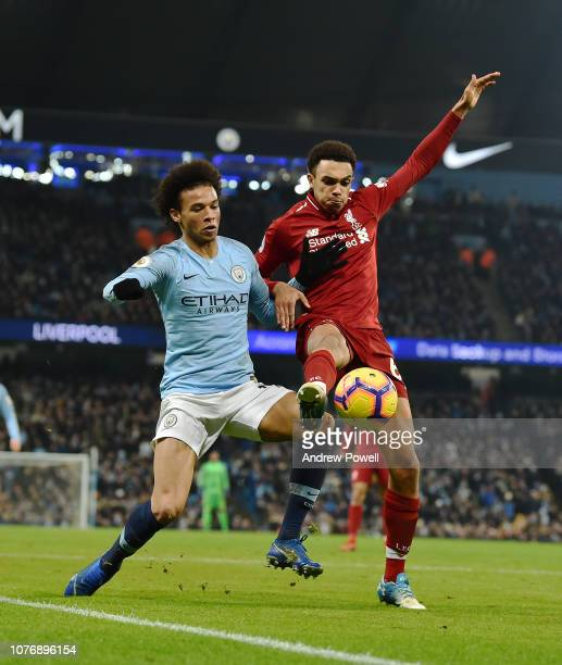 Trent AlexanderArnold of Liverpool with Leroy Sane during the Premier League match between Manchester City and Liverpool FC at Etihad Stadium on...