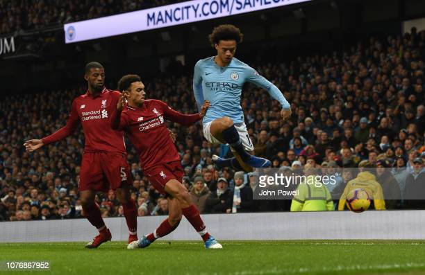 Trent AlexanderArnold of Liverpool with Leroy Sane of Man City during the Premier League match between Manchester City and Liverpool FC at Etihad...