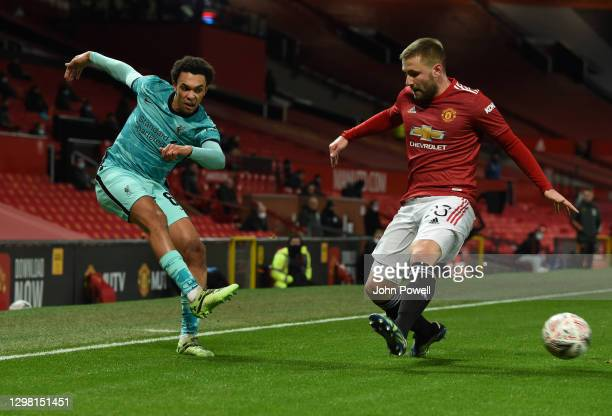 Trent Alexander-Arnold of Liverpool with Manchester United's Luke Shaw during The Emirates FA Cup Fourth Round match between Manchester United and...