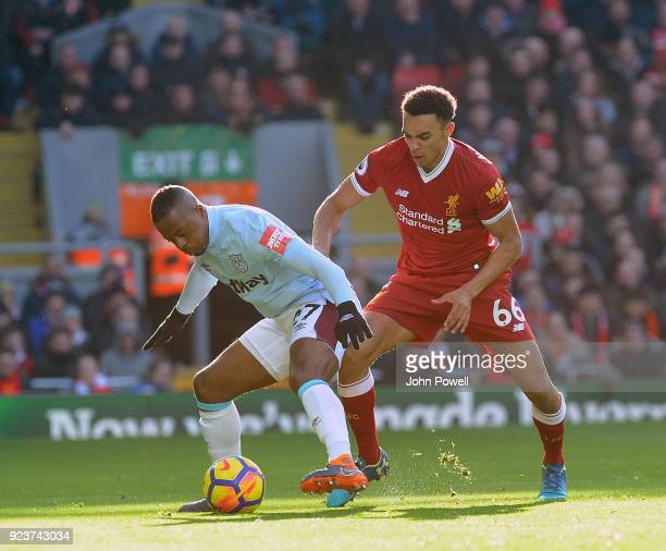 Trent AlexanderArnold of Liverpool With Patrice Evr of West Ham during the Premier League match between Liverpool and West Ham United at Anfield on...