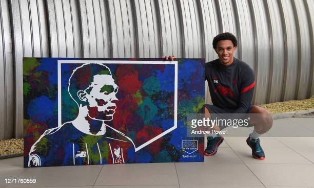 Trent Alexander-Arnold of Liverpool with the Premier League Young Player of the Year award at Melwood Training Ground on September 10, 2020 in...