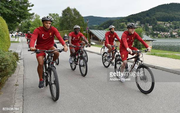 Trent AlexanderArnold Sadio Mane Mohamed Salah and Alberto Moreno of Liverpool on a bike riding to a training session at RottachEgern on July 27 2017...