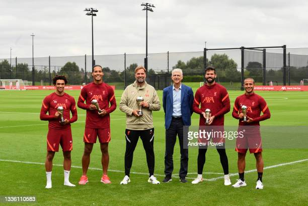 Trent Alexander-Arnold, Virgil van Dijk, Alisson Becker and Thiago Alcantara of Liverpool after receiving the 2020 world best 11 football players...