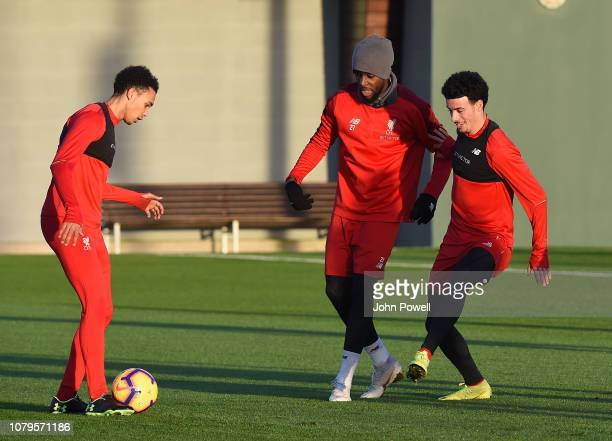Trent AlexanderArnold with Divock Origi and Curtis Jones of Liverpool during a training session at Melwood Training Ground on January 9 2019 in...