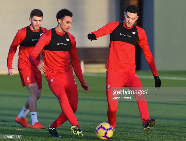 Trent AlexanderArnold with Issac ChristieDavies and Adam Lewis of Liverpool during a training session at Melwood Training Ground on January 9 2019 in...