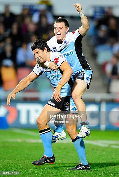 Trent Barrett and Nathan Gardner of the Sharks celebrate after winning the round 16 NRL match between the North Queensland Cowboys and the Cronulla...
