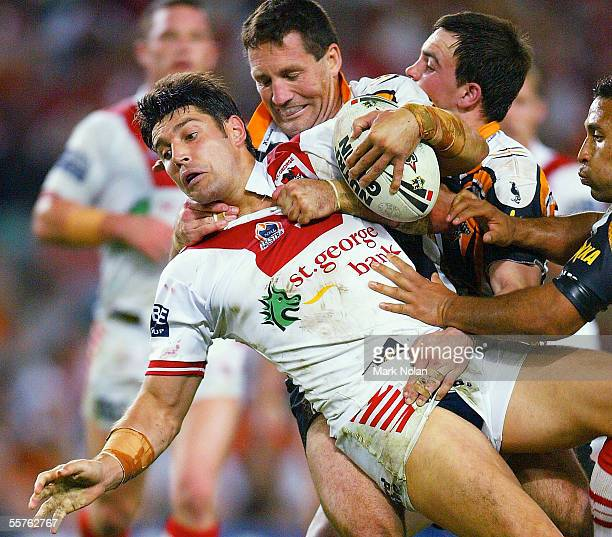 Trent Barrett of the Dragons is tackled during the NRL Preliminary Final between the St George Illawarrra Dragons and Wests Tigers at Aussie Stadium...