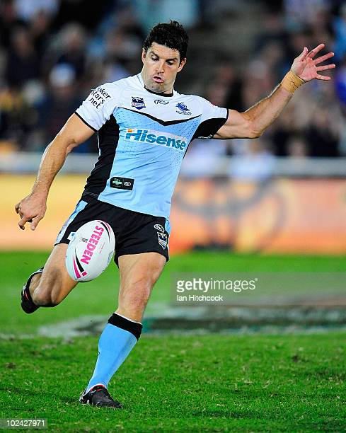 Trent Barrett of the Sharks kicks the ball during the round 16 NRL match between the North Queensland Cowboys and the Cronulla Sharks at Dairy...