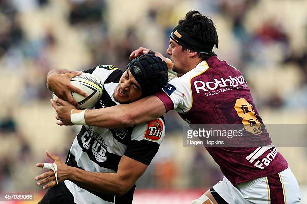 Trent BoswellWakefield of Hawke's Bay is tackled by Elliot Dixon of Southland during the round nine ITM Cup match between Hawke's Bay and Southland...