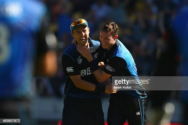 Trent Boult and Adam Milne of New Zealand celebrate as the final England wicket falls during the 2015 ICC Cricket World Cup match between England and...
