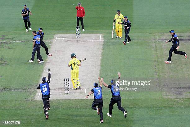 Trent Boult and Daniel Vettori of New Zealand celebrate the wicket of Aaron Finch of Australia during the 2015 ICC Cricket World Cup final match...