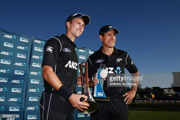 Trent Boult and Ross Taylor of New Zealand celebrate with the ChappellHadlee Trophy and ANZ Series Trophy after winning game three of the One Day...