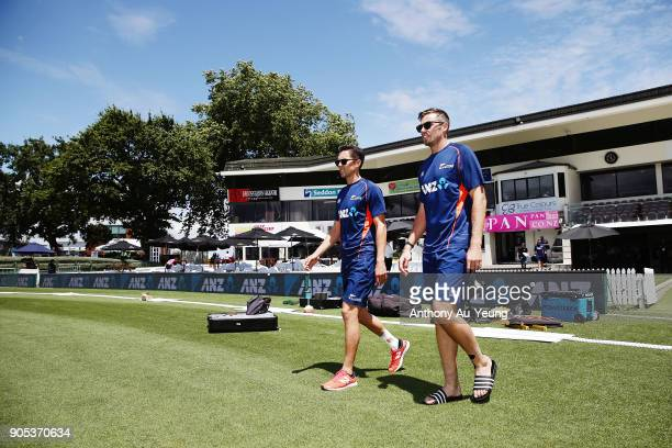 Trent Boult and Tim Southee of New Zealand walk out to inspect the pitch prior to game four of the One Day International Series between New Zealand...