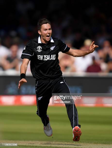 Trent Boult of New Zealand appeals successfully for the wicket of Jason Behrendorff and his hat-trick during the Group Stage match of the ICC Cricket...
