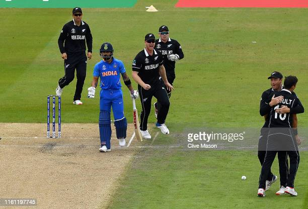 Trent Boult of New Zealand appeals successfully for the wicket of Virat Kohli of India during the Semi-Final match of the ICC Cricket World Cup 2019...