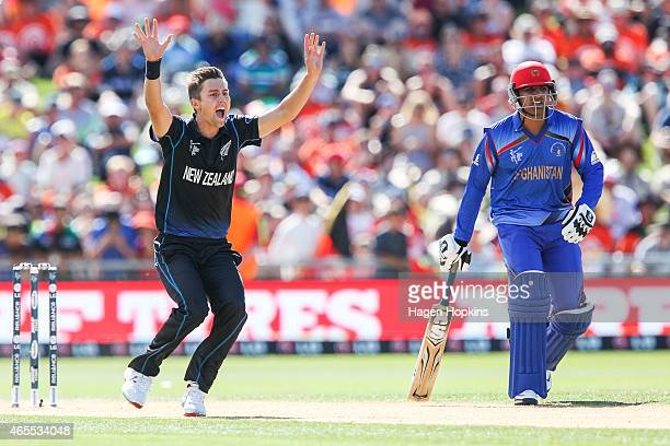 Trent Boult of New Zealand appeals successfully for the wicket of Javed Ahmadi of Afghanistan while Usman Ghani looks on during the 2015 ICC Cricket...