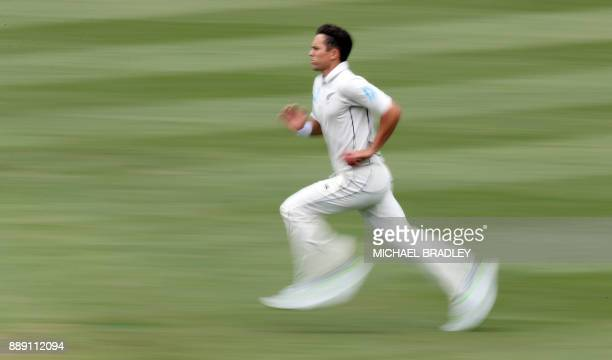 Trent Boult of New Zealand bowls during day two of the second Test cricket match between New Zealand and the West Indies at Seddon Park in Hamilton...
