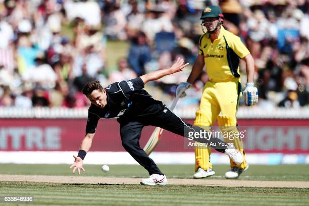 Trent Boult of New Zealand catches his own bowl during game three of the One Day International series between New Zealand and Australia at Seddon...