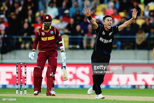 Trent Boult of New Zealand celebrates after claiming the wicket of Denesh Ramdin of West Indies during the 2015 ICC Cricket World Cup match between...
