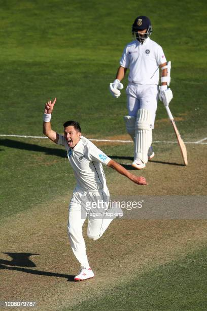 Trent Boult of New Zealand celebrates after taking the wicket of Virat Kohli of India during day three of the First Test match between New Zealand...