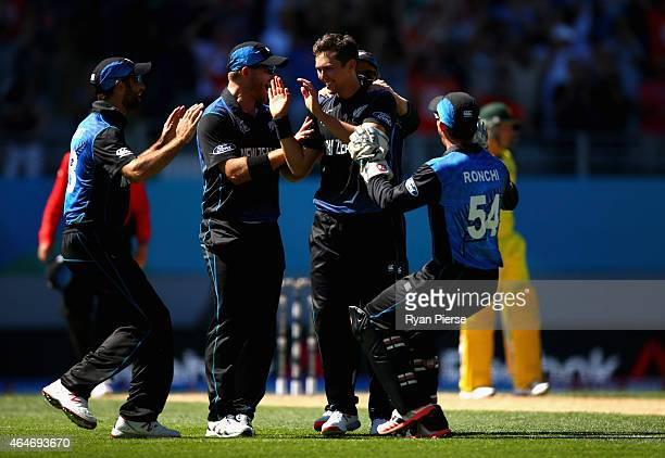 Trent Boult of New Zealand celebrates after taking the wicket of Mitch Marsh of Australia during the 2015 ICC Cricket World Cup match between...