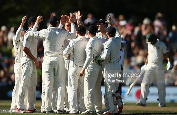 Trent Boult of New Zealand celebrates after taking the wicket of David Warner of Australia during day one of the Test match between New Zealand and...