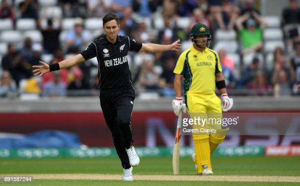 Trent Boult of New Zealand celebrates dismissing David Warner of Australia during the ICC Champions Trophy match between Australia and New Zealand at...