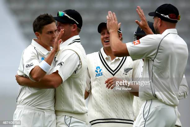 Trent Boult of New Zealand celebrates his wicket of Cheteshwar Pujara of India with Neil Wagner during day two of the First Test match between New...