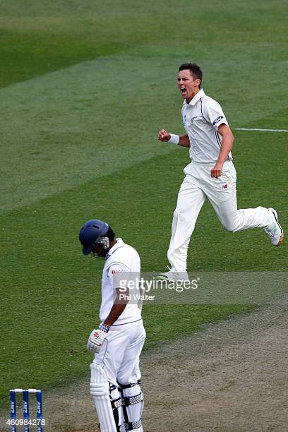 Trent Boult of New Zealand celebrates his wicket of Dimuth Karunaratne of Sri Lanka during day one of the Second Test match between New Zealand and...