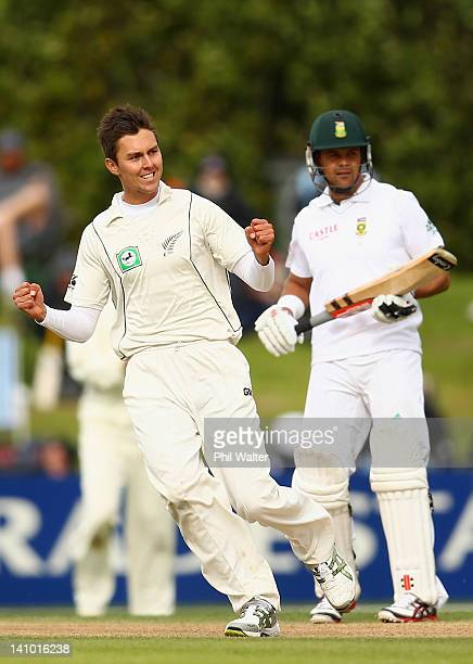 Trent Boult of New Zealand celebrates his wicket of Jacques Kallis of South Africa as Jacques Rudolph looks on during day four of the First Test...