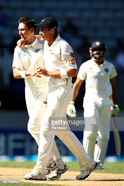 Trent Boult of New Zealand celebrates his wicket of Ravindra Jadeja of India with Tim Southee during day four of the First Test match between New...