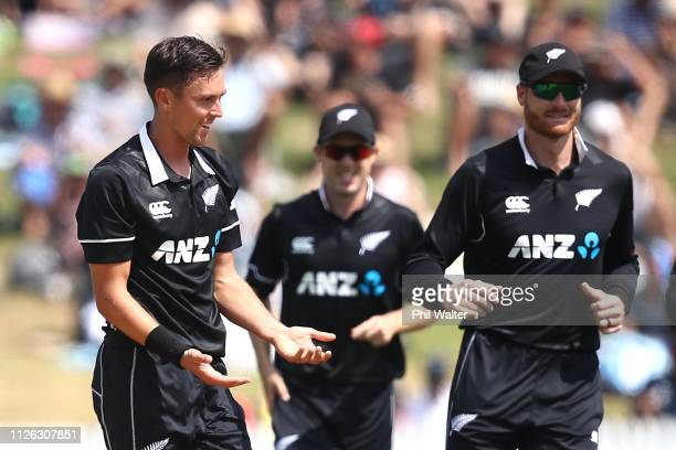 Trent Boult of New Zealand celebrates his wicket of Shikhar Dhawan of India during game four of the One Day International series between New Zealand...