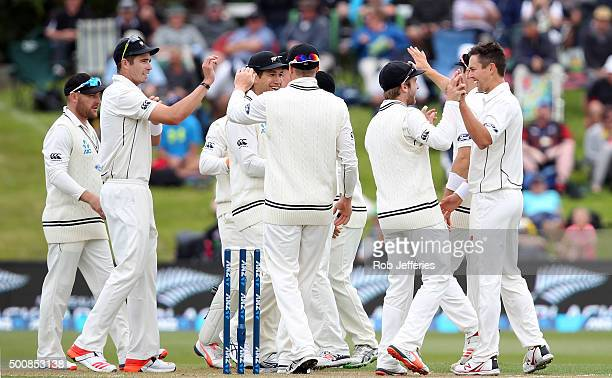 Trent Boult of New Zealand celebrates taking the wicket of Kusal Mendis of Sri Lanka during day two of the First Test match between New Zealand and...