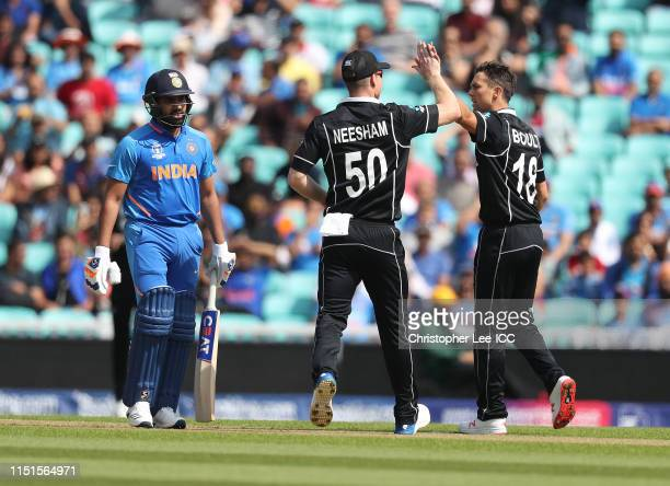 Trent Boult of New Zealand celebrates taking the wicket of Rohit Sharma of India during the ICC Cricket World Cup 2019 Warm Up match between India...