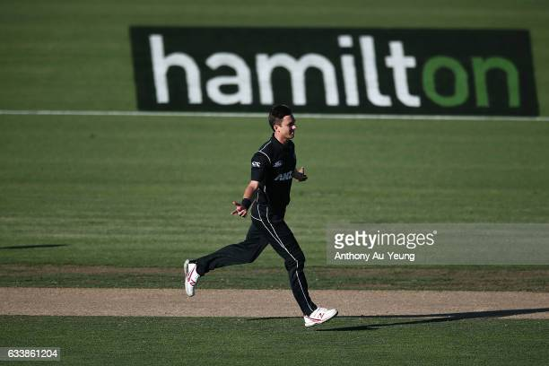 Trent Boult of New Zealand celebrates the wicket of Adam Zampa of Australia during game three of the One Day International series between New Zealand...