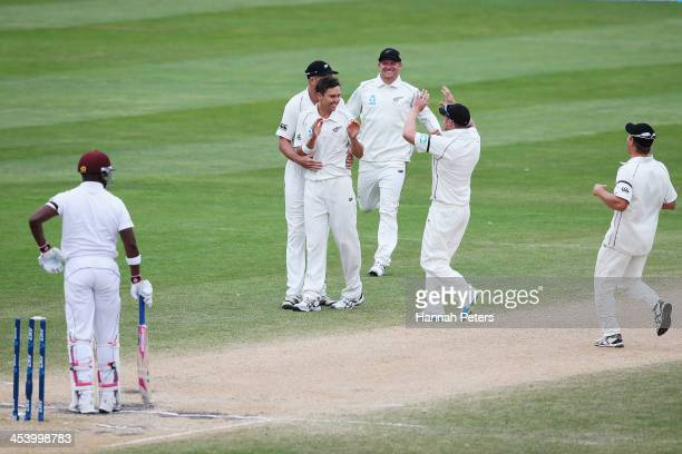 Trent Boult of New Zealand celebrates the wicket of Darren Bravo of the West Indies during day five of the first test match between New Zealand and...