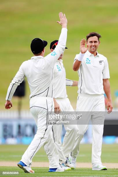 Trent Boult of New Zealand celebrates the wicket of Miguel Cummins of the West Indies during day three of the Second Test Match between New Zealand...