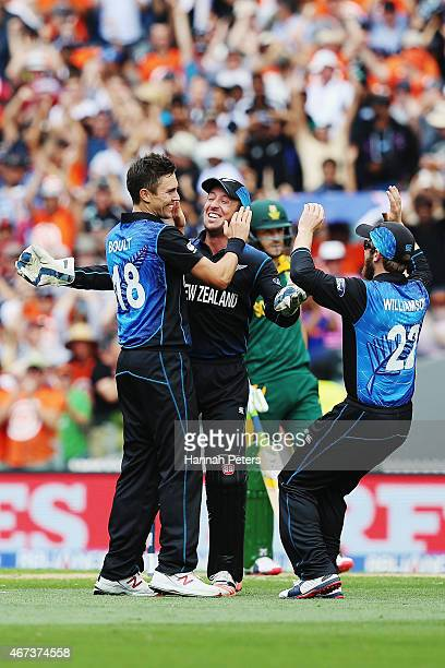 Trent Boult of New Zealand celebrates the wicket of Quinton de Kock of South Africa during the 2015 Cricket World Cup Semi Final match between New...