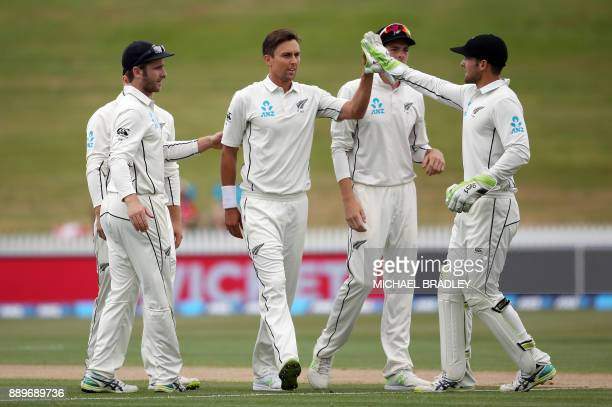Trent Boult of New Zealand celebrates the wicket of West Indies Miguel Cummins during day three of the second Test cricket match between New Zealand...