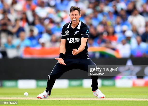 Trent Boult of New Zealand celebrates trapping Virat Kohli of India LBW during the Semi-Final match of the ICC Cricket World Cup 2019 between India...