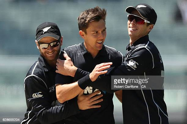 Trent Boult of New Zealand celebrates with Kane Williamson and Mitchell Santner after taking the wicket of Steve Smith of Australia during game three...