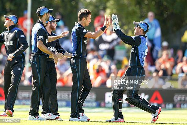 Trent Boult of New Zealand celebrates with team mates after dismissing Calum Macleod of Scotland during the ICC Cricket World Cup match between New...
