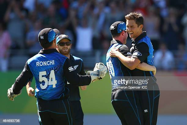 Trent Boult of New Zealand celebrates with team mates after dismissing Mitchell Johnson of Australia during the 2015 ICC Cricket World Cup match...